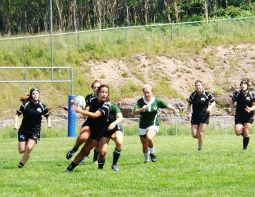 Katuscya Gauvin of the Black Tide runs by a Saint John Irish player.